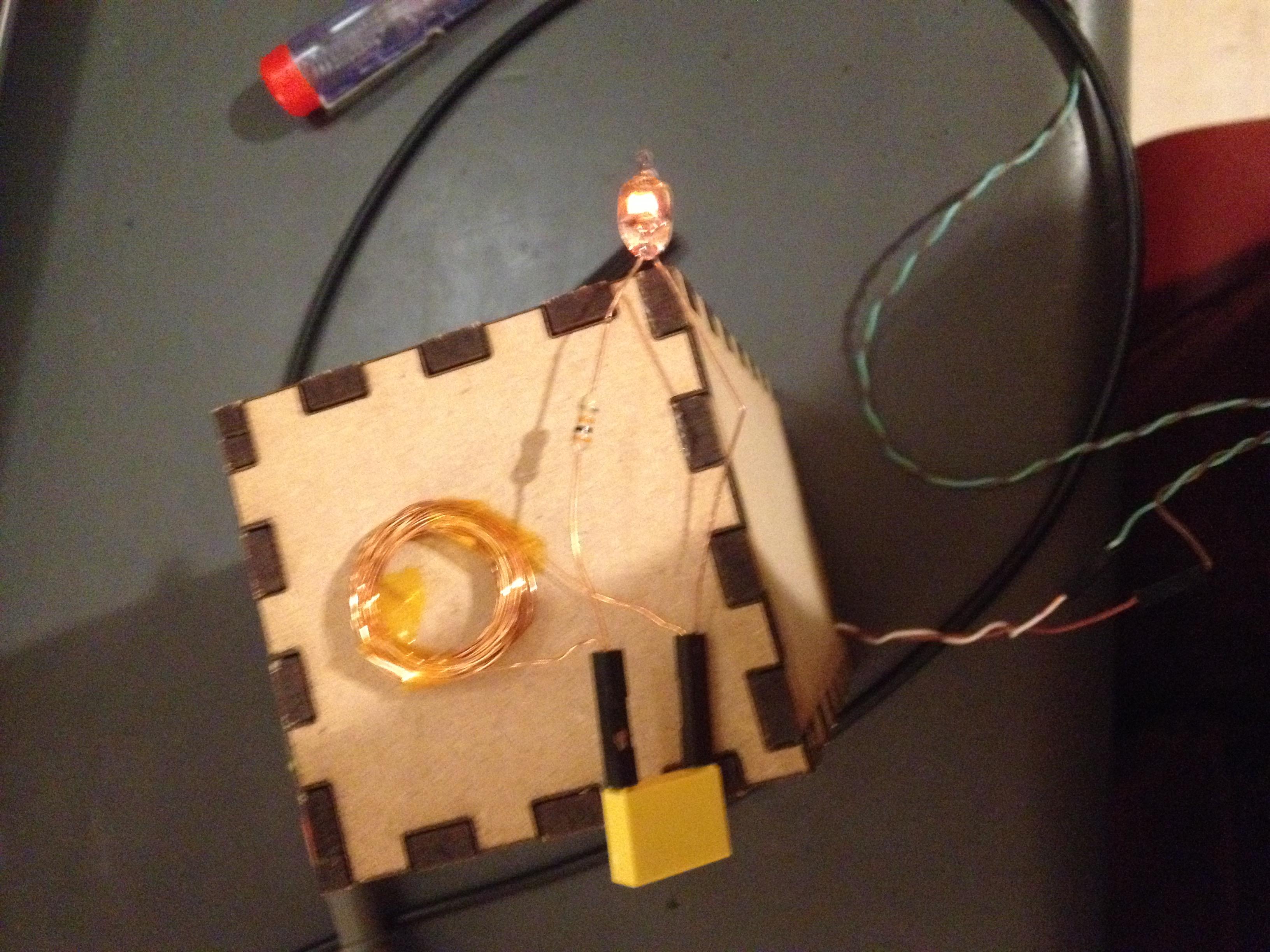 wireless power transfer to a neon bulb